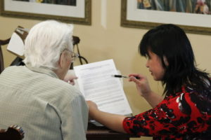 Senior citizen reviewing paperwork